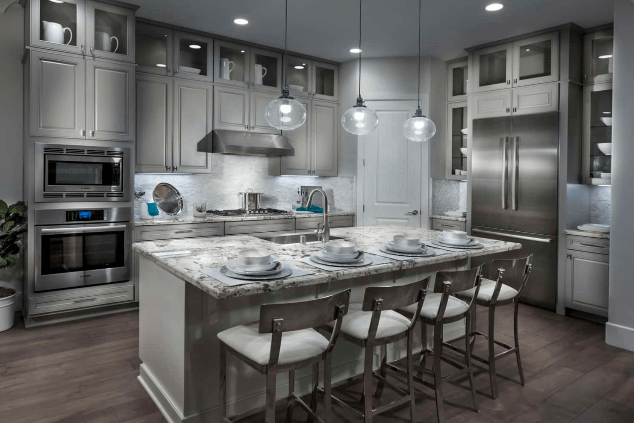 This metallic kitchen at The Enclave in Dublin, CA is one of our hot 2018 design trends.